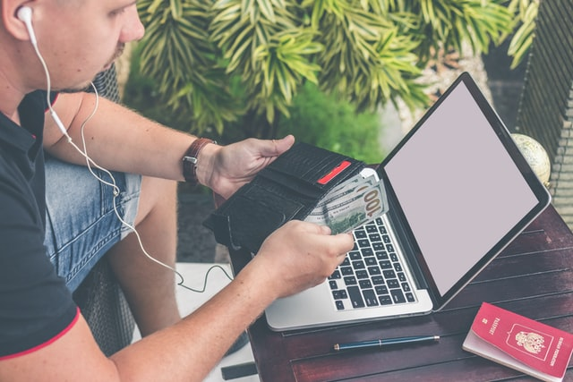 passport monay and laptop